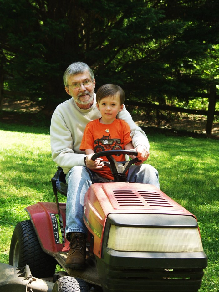 B. working hard, cutting the lawn with G-Pa