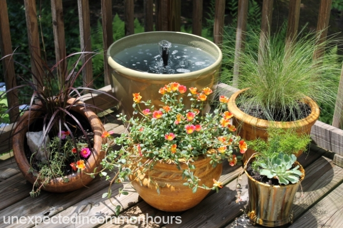 deck fountain and plantings