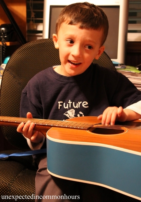 B. playing the guitar