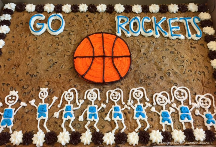 The team consisted of 7 boys and 2 girls, but the cake decorator got it backwards.